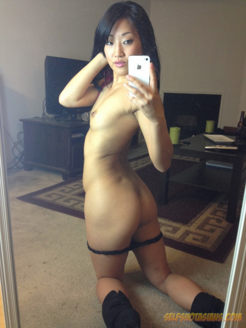 Asian cutie teases in a naked self shot